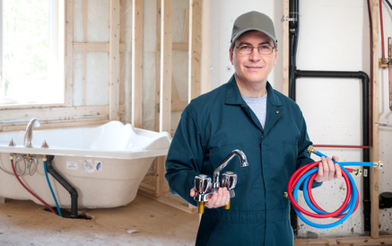 image of plumber making plumbing leak repair